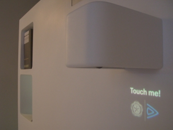 Projector light blue optics: touch me! Train your body and watching a movie